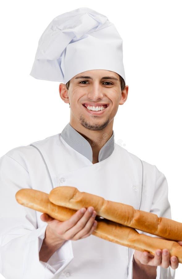 O cozinheiro do cozinheiro chefe entrega o pão foto de stock royalty free