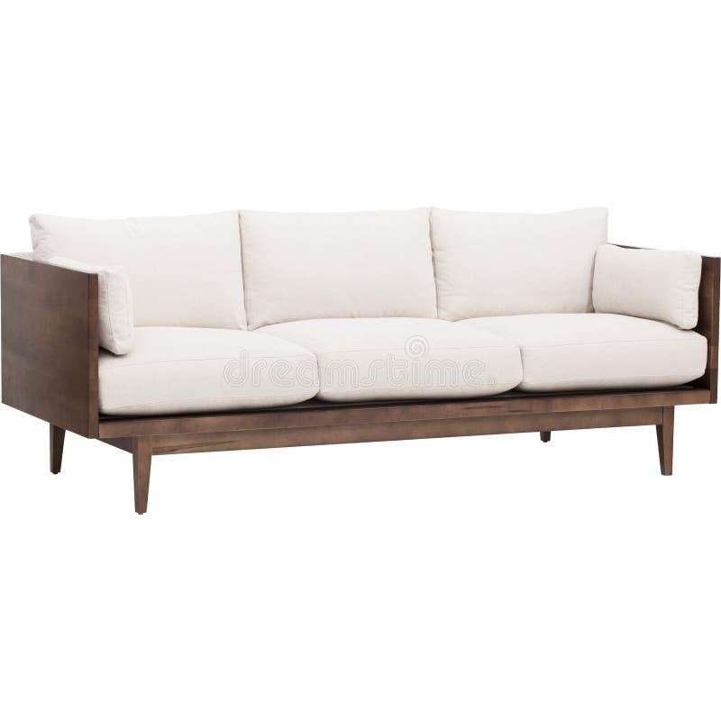 O creme confort?vel colore o sof? de madeira de tr?s seater com fundo branco - imagem conservada em estoque imagens de stock