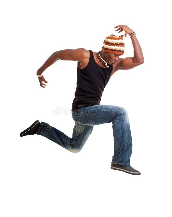 O dançarino de sorriso salta imagem de stock