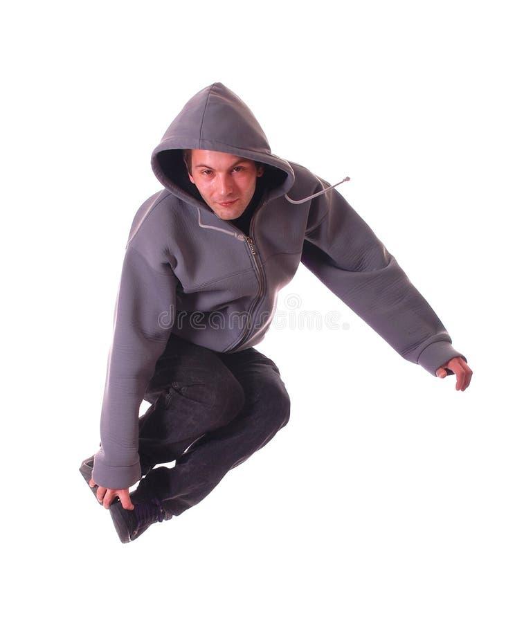 O dançarino masculino novo faz um salto imagem de stock