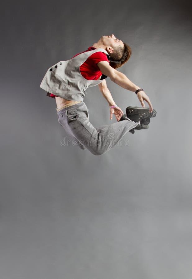 O dançarino que salta altamente imagem de stock