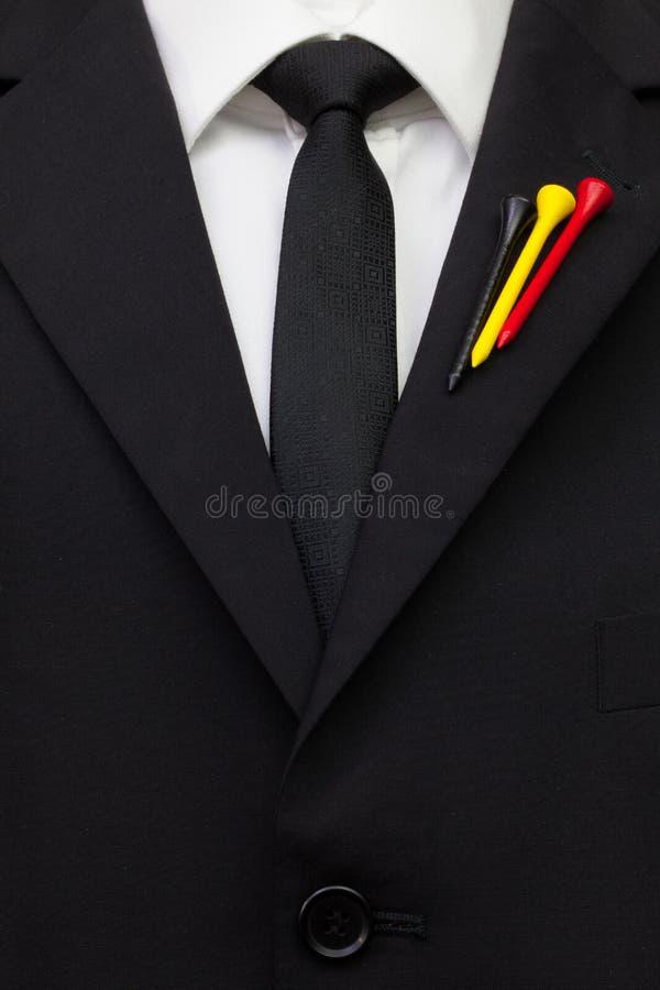 O detalhe de terno do casamento com projeto do golfe imagem de stock