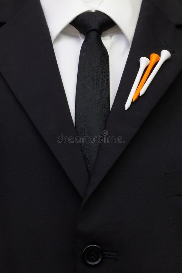 O detalhe de terno do casamento com projeto do golfe imagens de stock