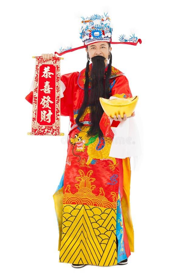 O deus da riqueza que guarda felicitações bobina e lingote do ouro imagem de stock royalty free