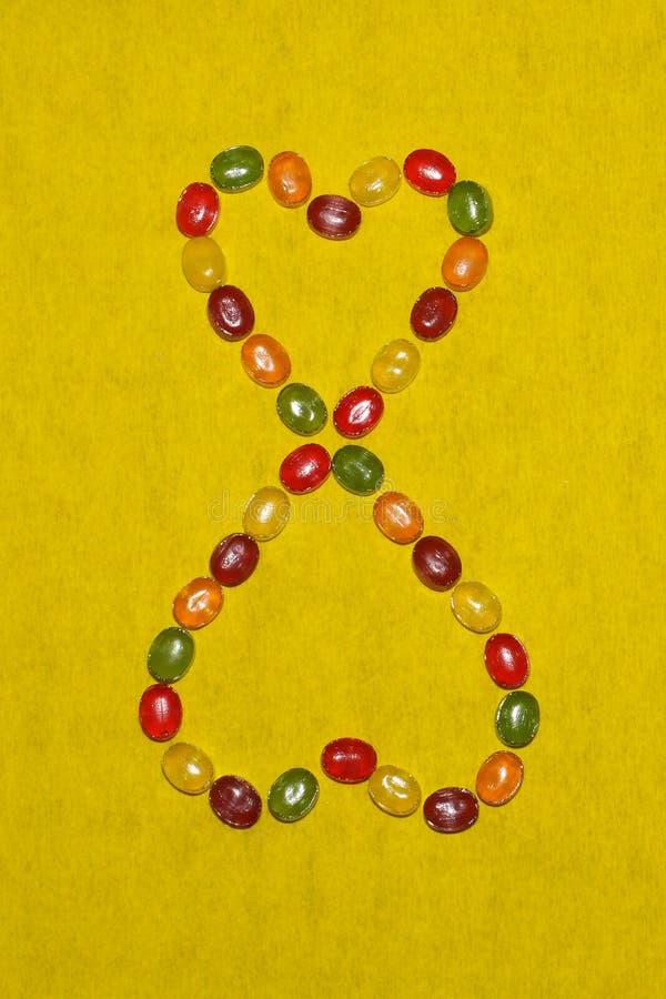 O dia das mulheres de oitavo março dos doces, oito na forma dos corações fotografia de stock