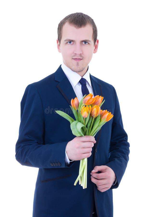 O dia das mulheres felizes - homem novo com grupo das tulipas no isolador das mãos fotos de stock