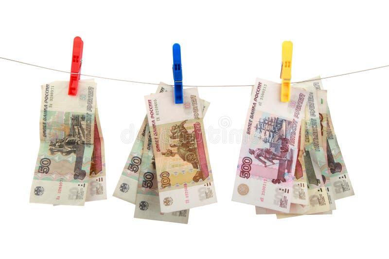 O dinheiro do russo pendura em clothespins fotografia de stock royalty free