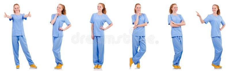 O doutor bonito no uniforme azul isolado no branco imagem de stock royalty free