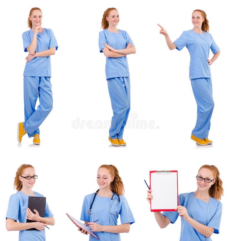 O doutor bonito no uniforme azul isolado no branco imagens de stock royalty free