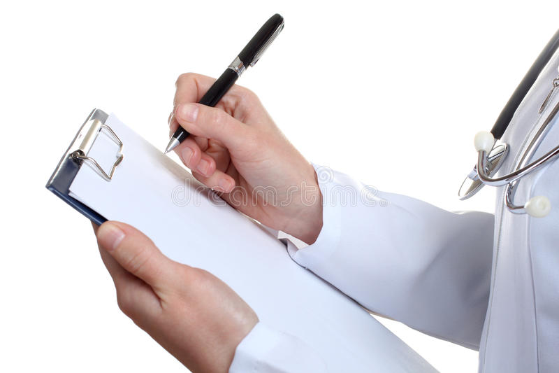 O doutor escreveu uma nota foto de stock royalty free