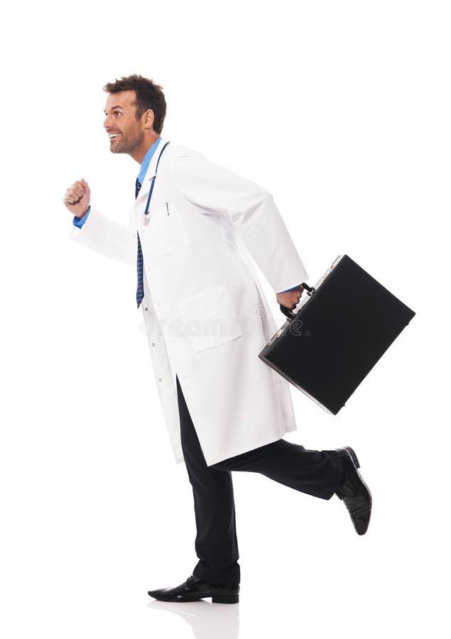 O doutor está correndo fotografia de stock royalty free