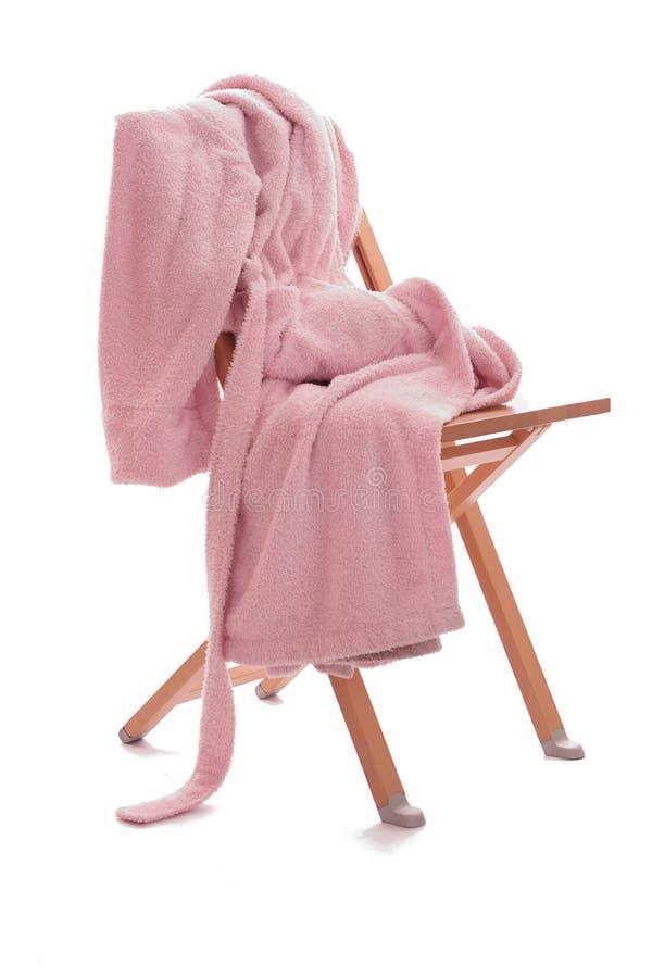 O Dressing-gown está na cadeira imagem de stock royalty free