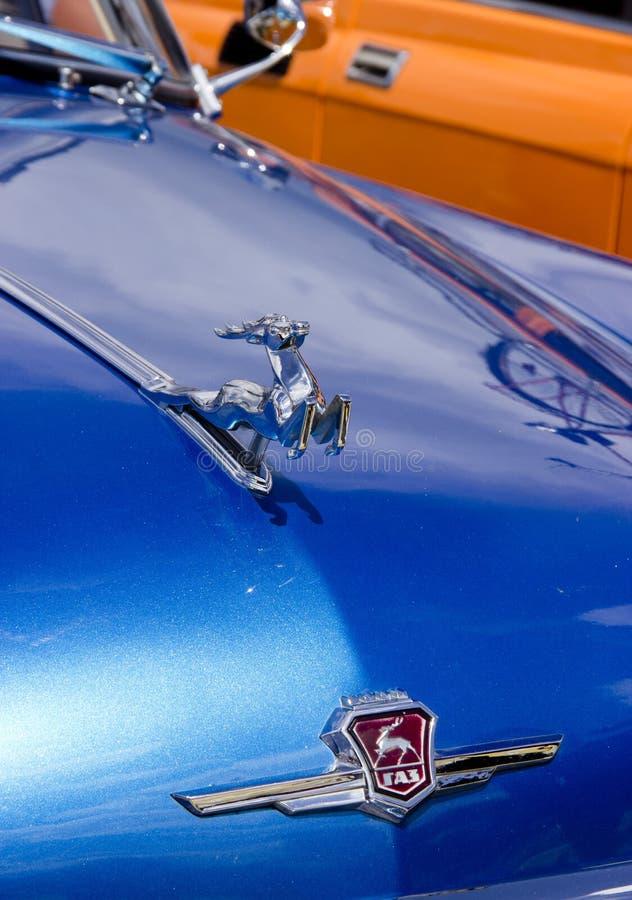 O emblema do GÁS do carro imagem de stock