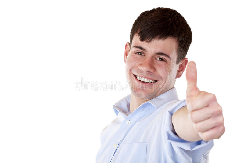 O empregado considerável novo mostra o polegar na câmera imagens de stock