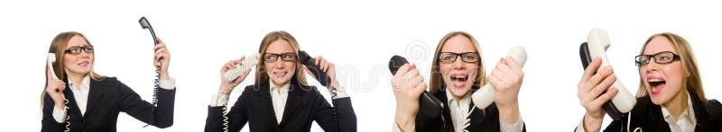 O empregado de escrit?rio bonito que mant?m o telefone isolado no branco foto de stock