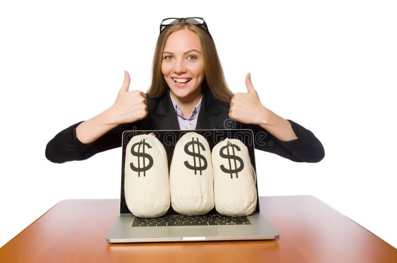 O empregado do sexo feminino com os sacos do dinheiro em sua tabela fotos de stock royalty free