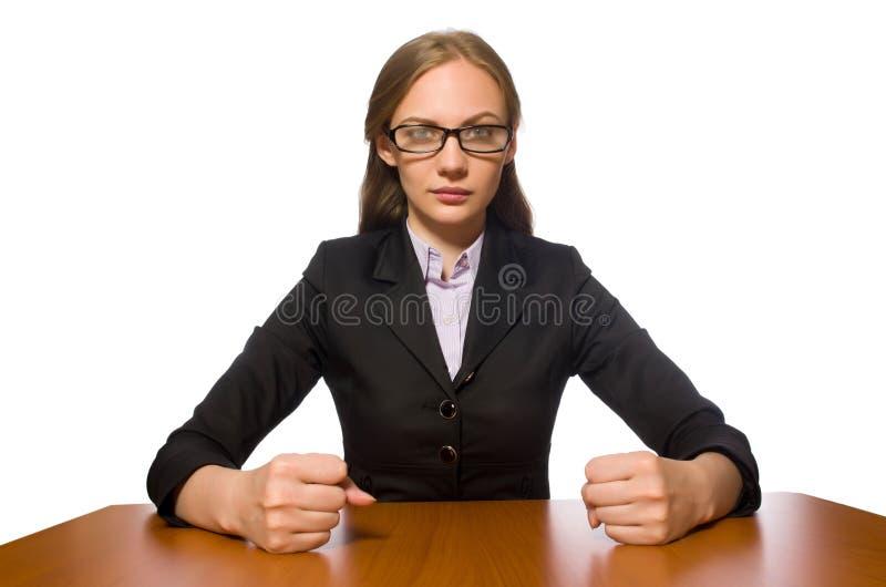 O empregado do sexo feminino que senta-se na tabela longa isolada no branco fotografia de stock royalty free