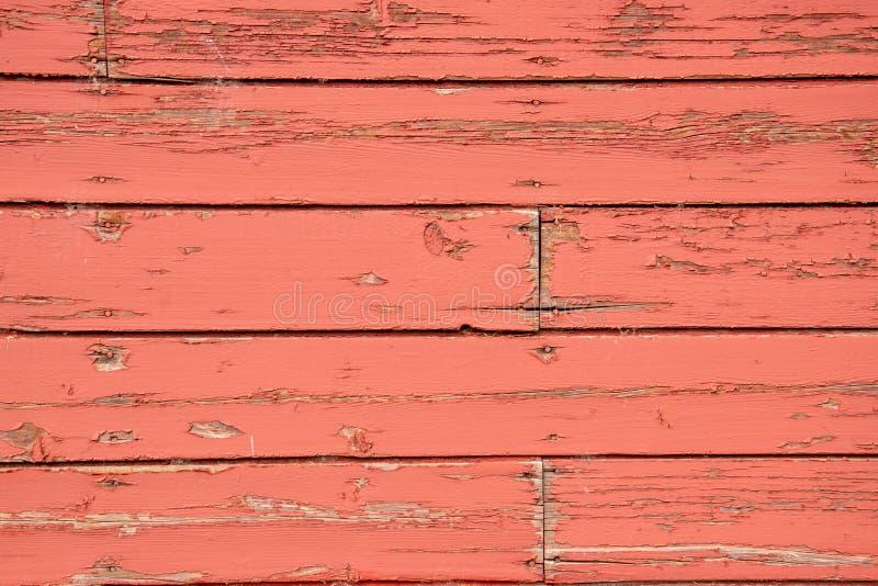 O envelhecimento embarca no lado de um celeiro vermelho velho fotografia de stock royalty free