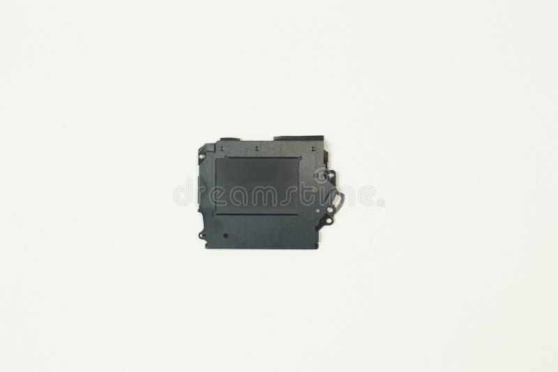O equipamento do obturador da câmera no Livro Branco para o fundo fotos de stock royalty free