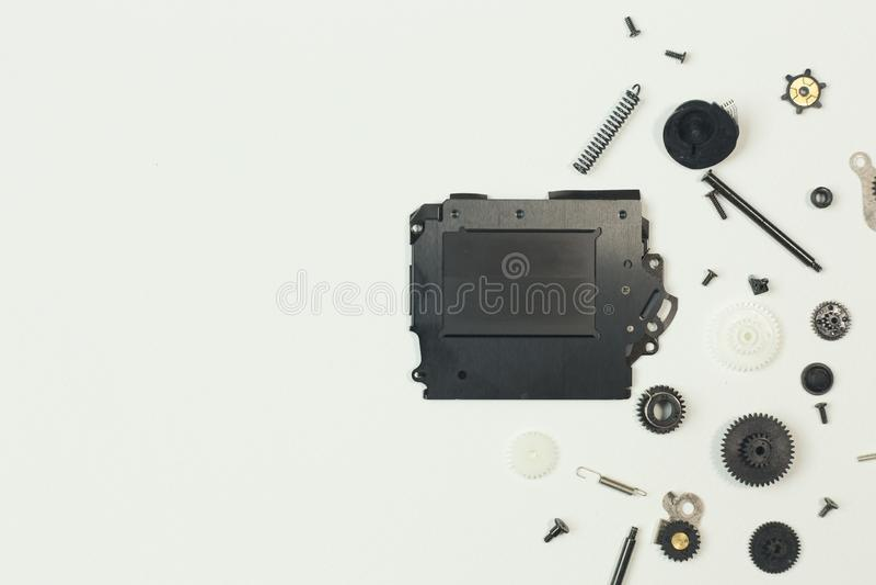 O equipamento do obturador da câmera no Livro Branco para o fundo imagem de stock royalty free