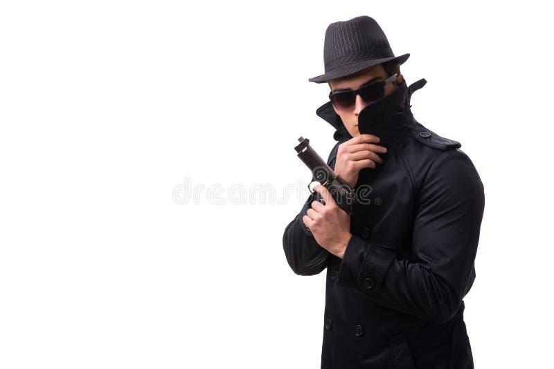 O espião do homem com o revólver isolado no fundo branco imagens de stock royalty free
