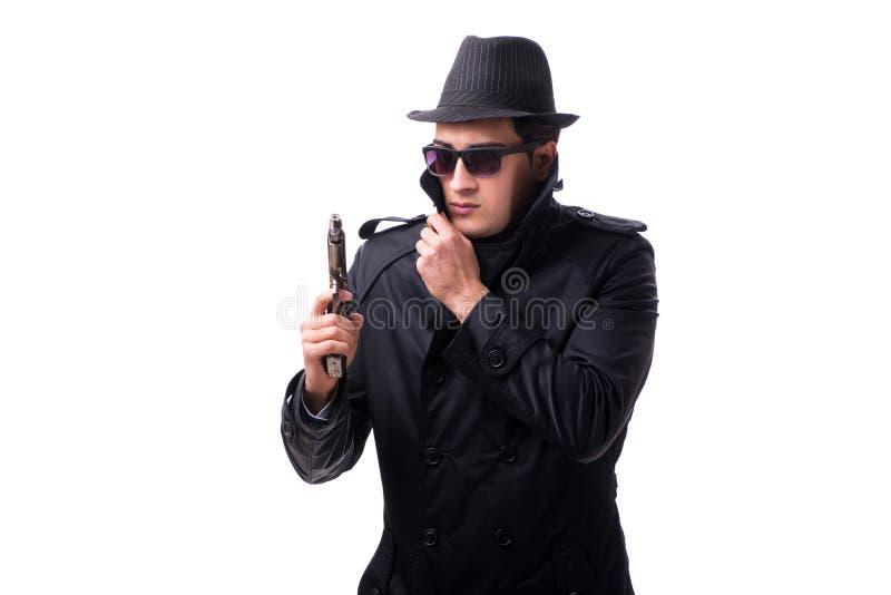 O espião do homem com o revólver isolado no fundo branco fotos de stock royalty free