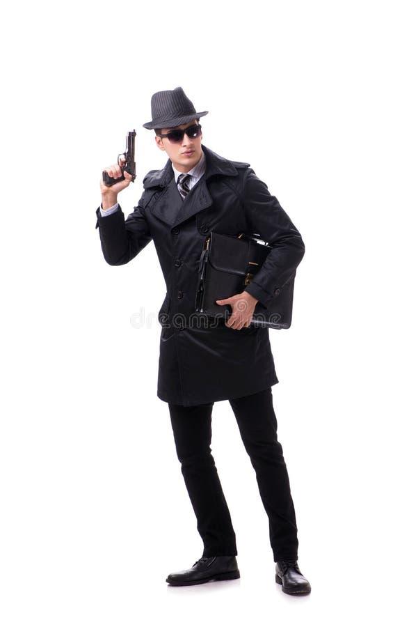 O espião do homem com o revólver no fundo branco fotografia de stock royalty free