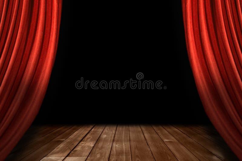 O estágio vermelho do teatro drapeja com assoalho de madeira foto de stock
