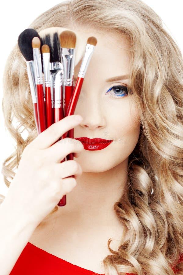 O estilista com compo escovas imagens de stock