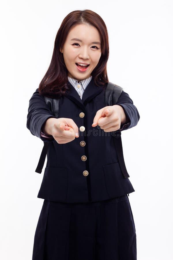 O estudante asiático bonito novo indica-o foto de stock royalty free