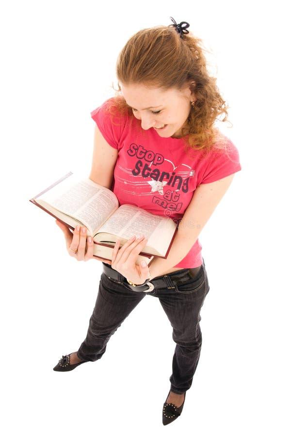O estudante com o livro isolado em um branco imagem de stock royalty free