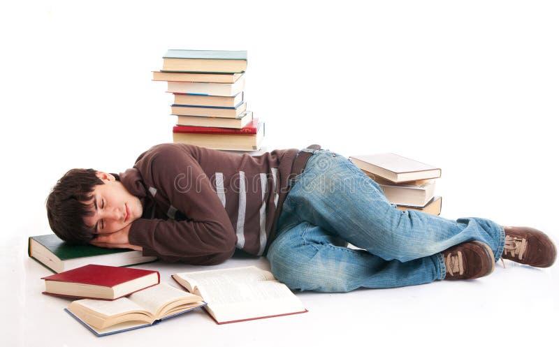 O estudante de sono com os livros fotografia de stock