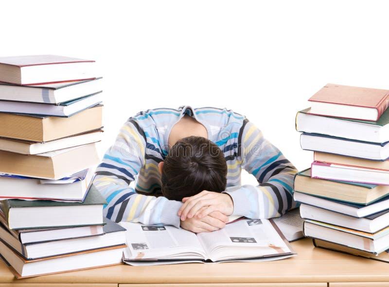 O estudante de sono com os livros isolados foto de stock
