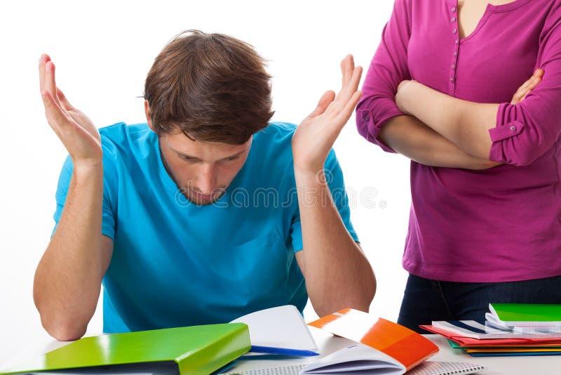 O estudante discorda com o professor fotos de stock royalty free