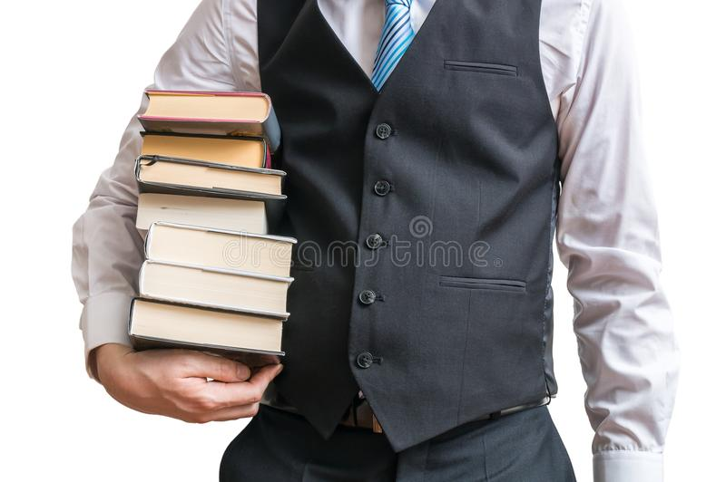 O estudante está guardando muitos livros nas mãos Isolado no fundo branco imagem de stock