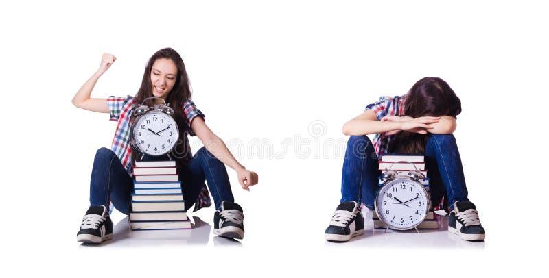 O estudante fêmea novo que falta seus fins do prazo no branco fotos de stock