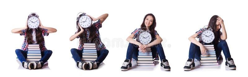 O estudante fêmea novo que falta seus fins do prazo no branco fotografia de stock royalty free