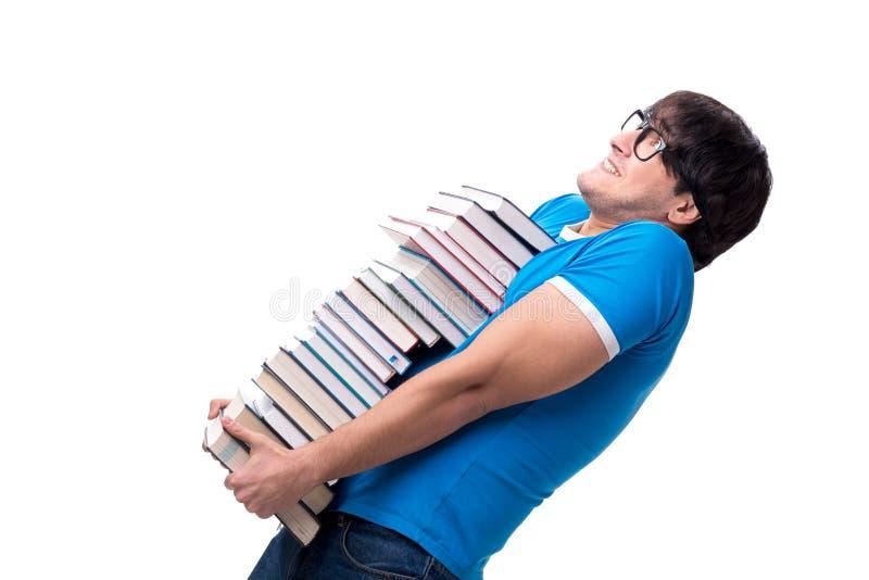 O estudante masculino com muitos livros isolados no branco foto de stock royalty free