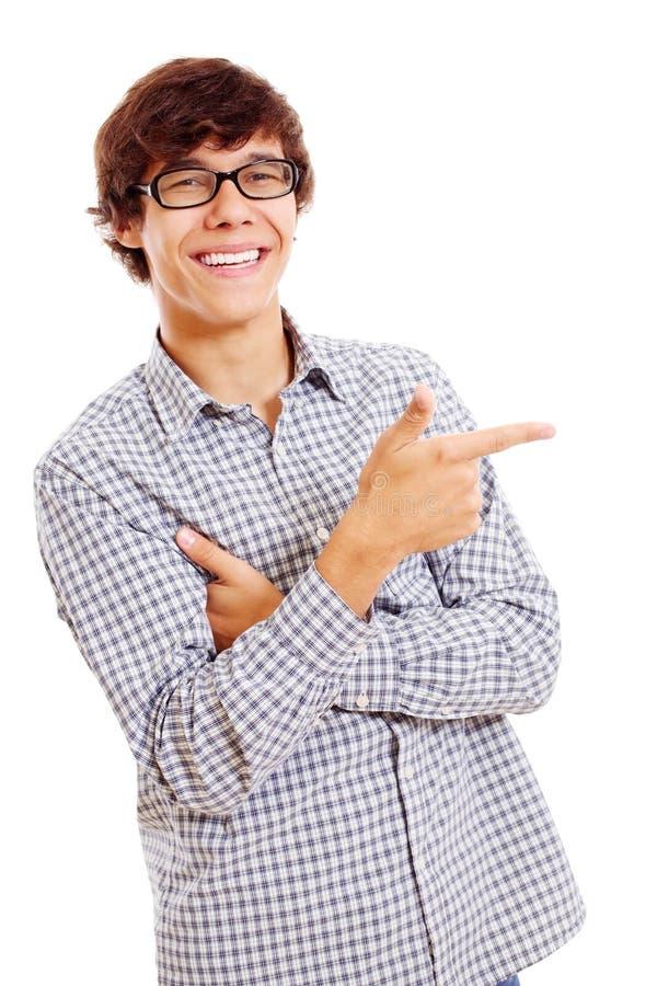 O estudante mostra o forefinger em algo foto de stock