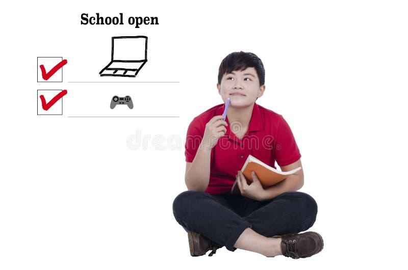 O estudante prepara a escola aberta foto de stock