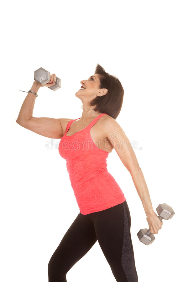 O exercício de uma mulher mais idosa torna mais pesado o verso principal fotografia de stock