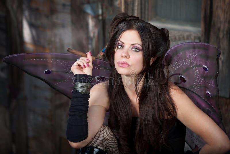 O Fairy prende um charuto foto de stock