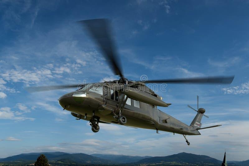 O falcão militar 3d realístico do preto do helicóptero UH-60 rende ilustração royalty free