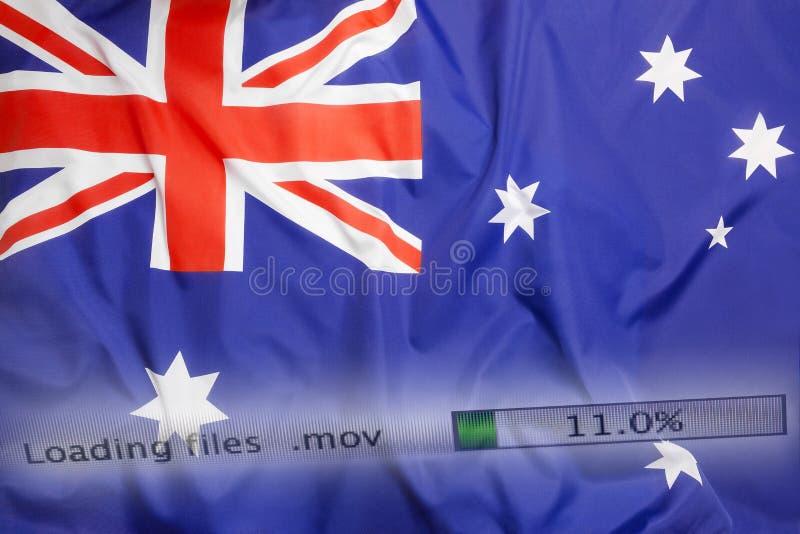 O fazendo download arquiva em um computador, bandeira de Austrália foto de stock royalty free