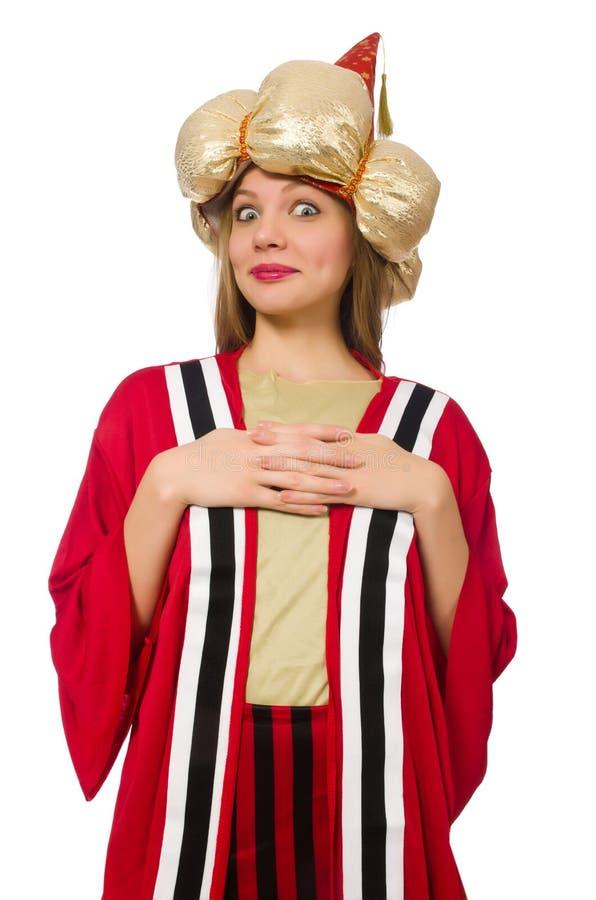 O feiticeiro da mulher na roupa vermelha isolada no branco imagem de stock royalty free