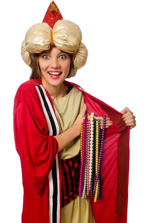 O feiticeiro da mulher na roupa vermelha isolada no branco foto de stock
