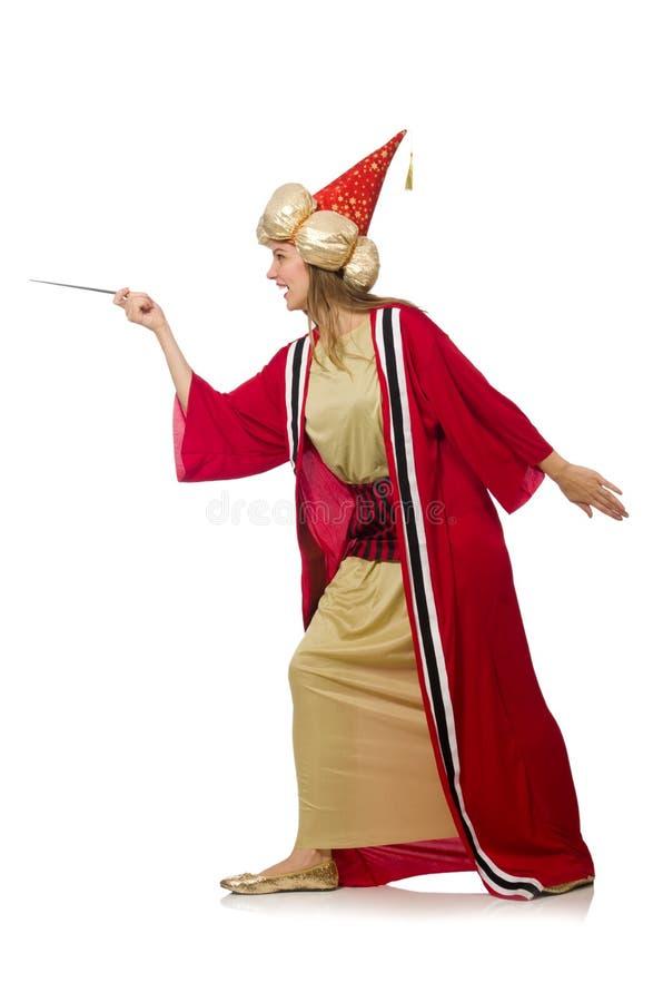 O feiticeiro da mulher na roupa vermelha isolada no branco fotografia de stock