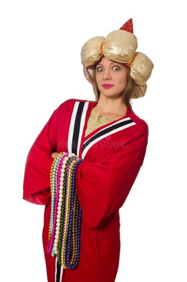 O feiticeiro da mulher na roupa vermelha isolada no branco imagens de stock royalty free