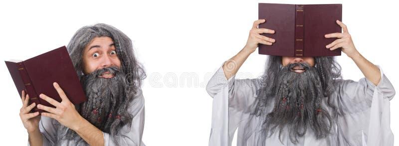 O feiticeiro idoso engraçado com livro imagens de stock