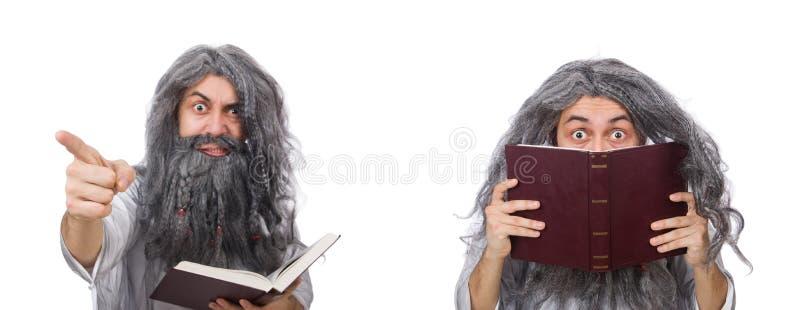 O feiticeiro idoso engra?ado com livro imagem de stock royalty free